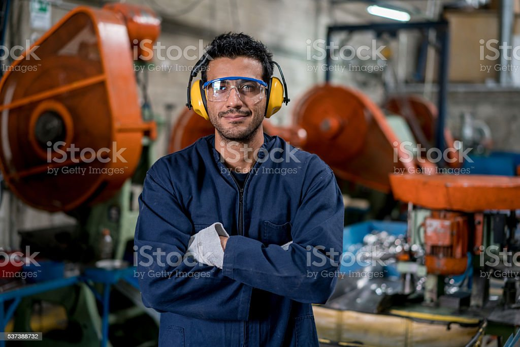 Man working at a factory stock photo