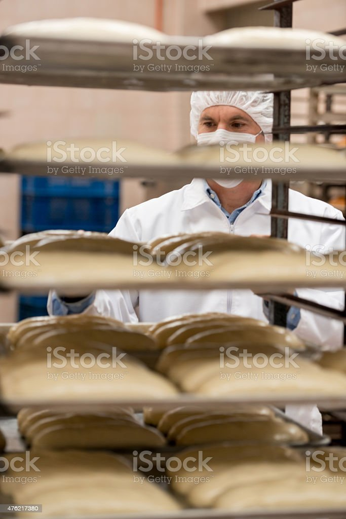 Man working at a food factory stock photo