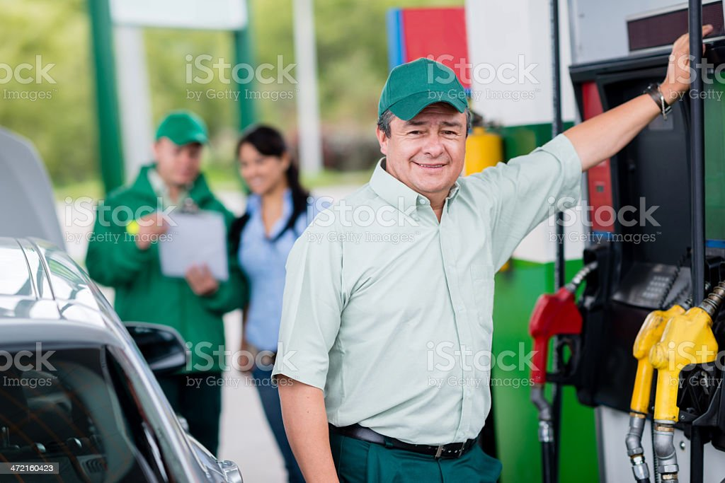 Man working at a gas station stock photo