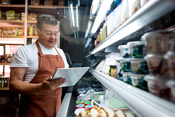 Man working at a grocery store stock photo
