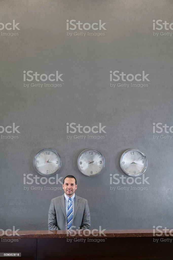 Man working at a hotel reception stock photo