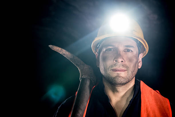 Man working at a mine stock photo