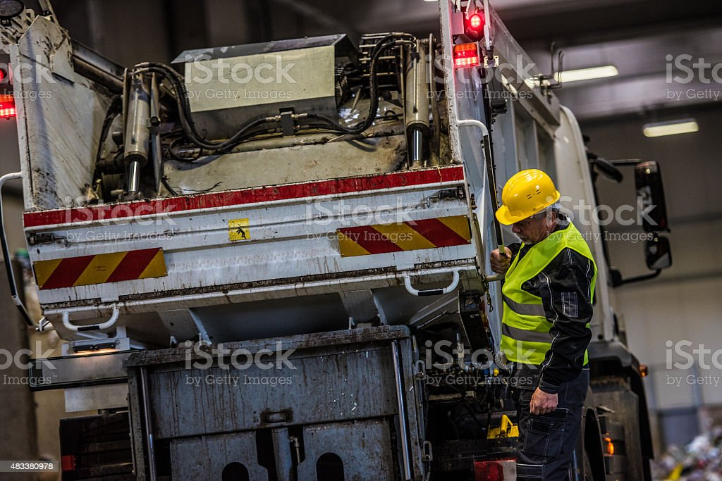 Man working at garbage recycling plant stock photo