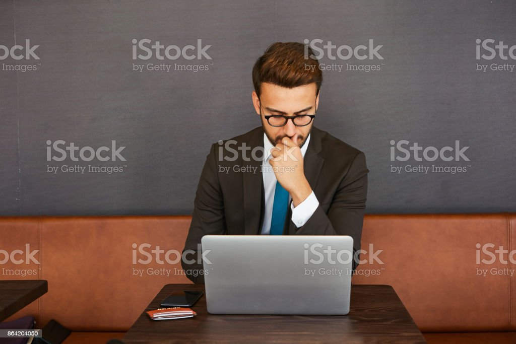 A man working at home and online shopping royalty-free stock photo