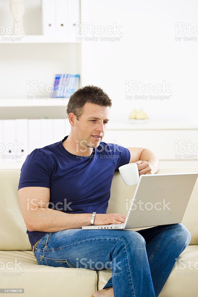 Man working at home on laptop royalty-free stock photo