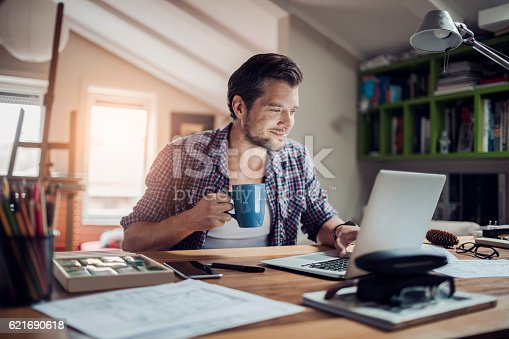 istock Man working at home 621690618
