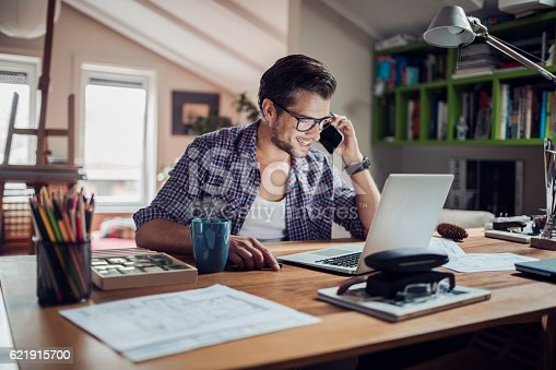 istock Man working at home 621915700