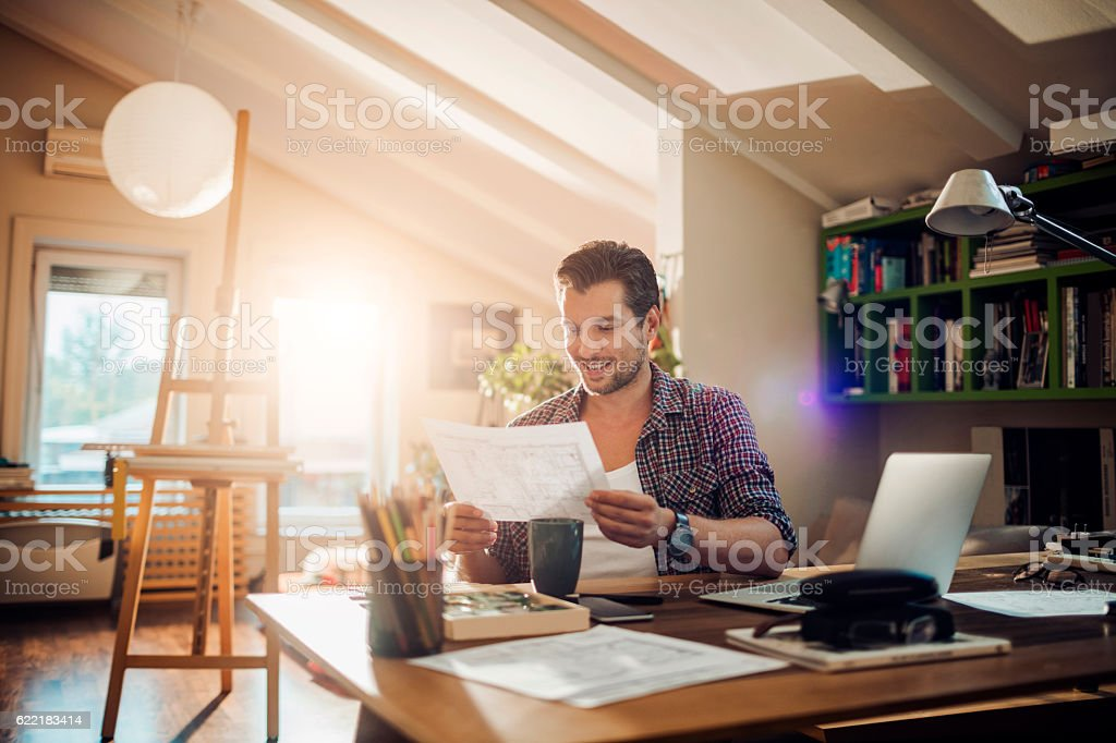 Man working at home stock photo