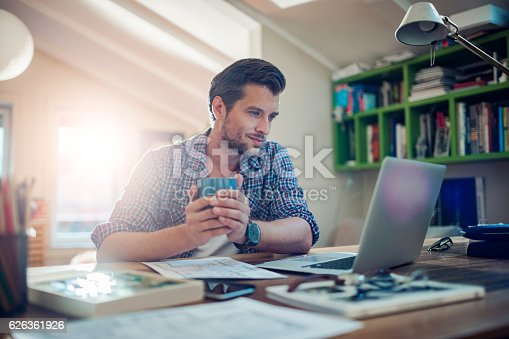 Photo of a man working from home