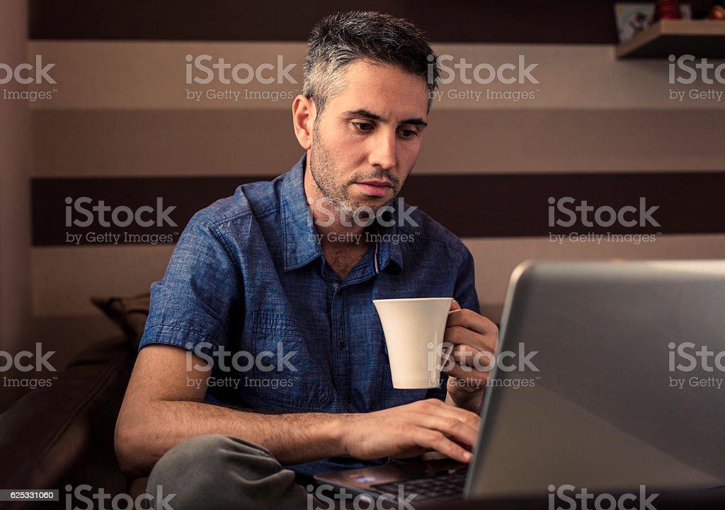 Man working at laptop stock photo