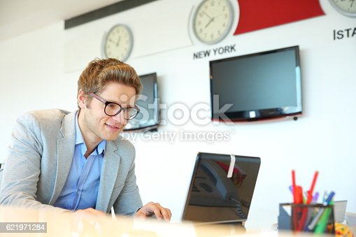 513583458 istock photo Man working at modern office 621971284