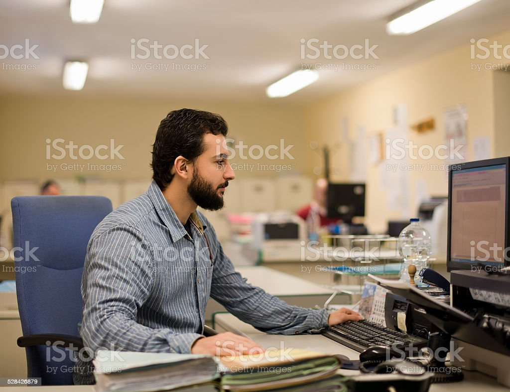 Man working at office stock photo