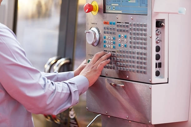 Man working at programmable machine stock photo