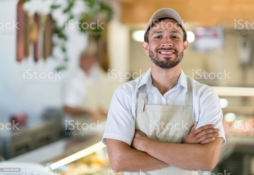 Man working at the butcher's shop stock photo