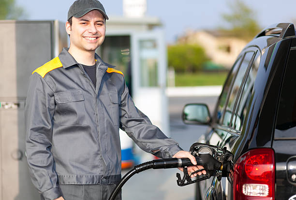man working at the gas station stock photo