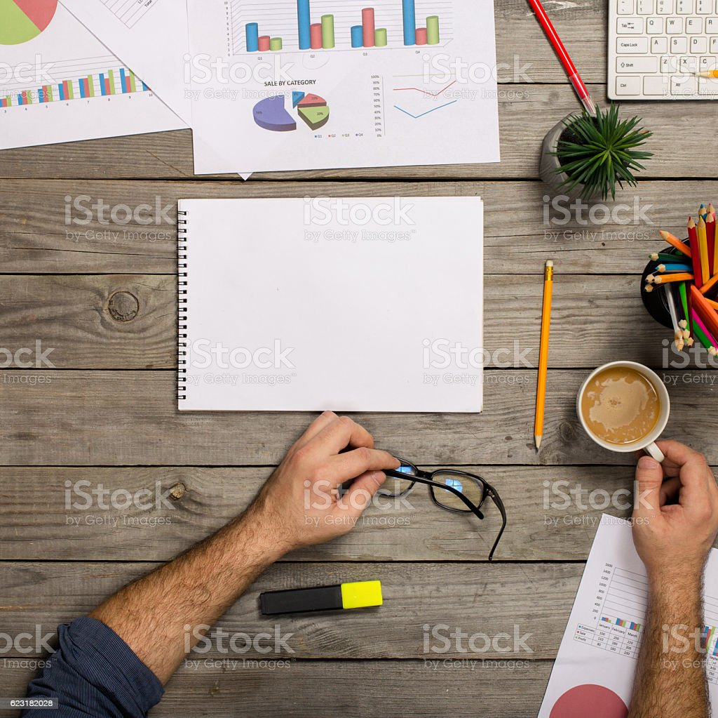 Man working behind office wooden desk top view stock photo
