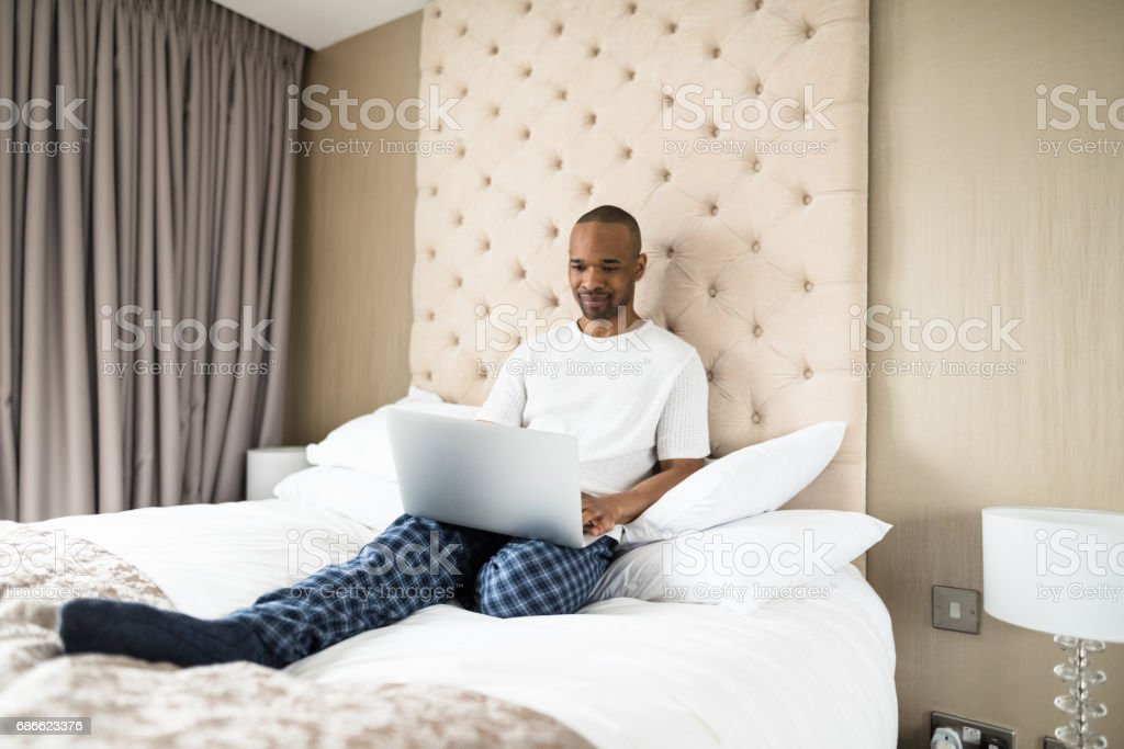 man working from the bedroom hotel royalty-free stock photo