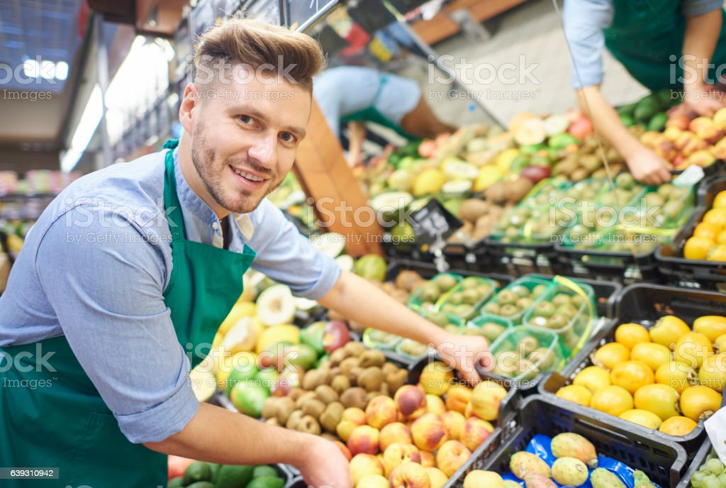 Man working hard in supermarket stock photo
