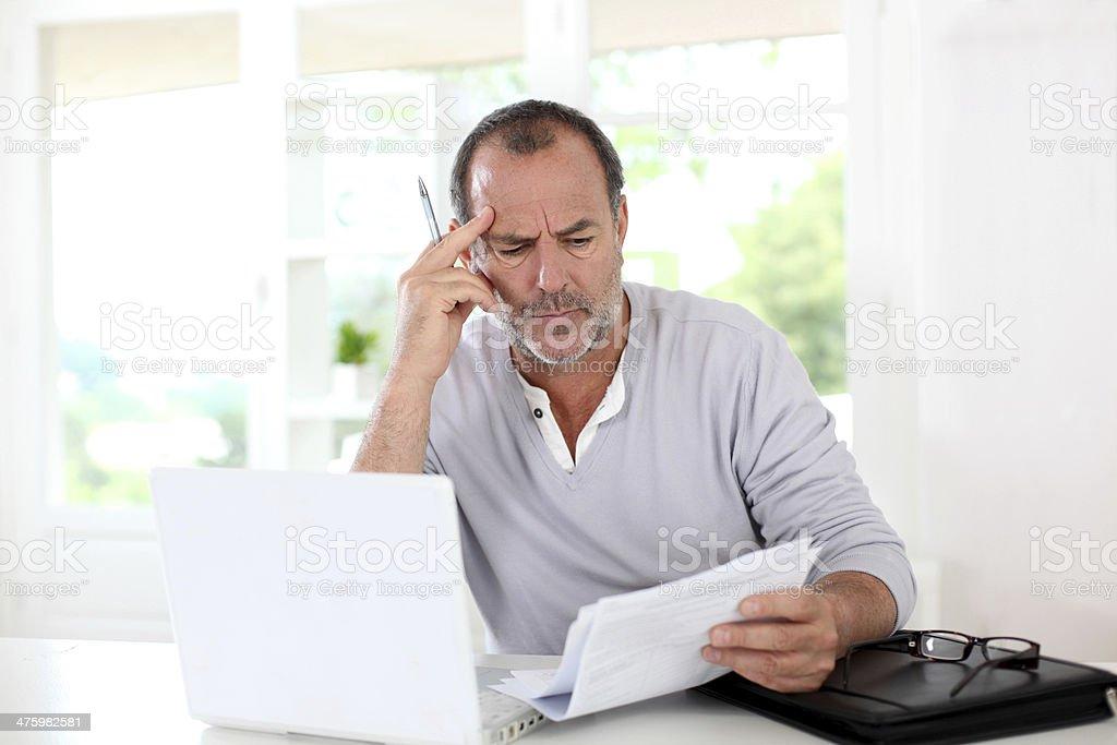 Man working hard with serious attitude stock photo