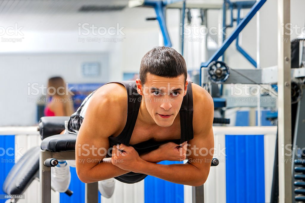 Man working his  back on hyperextension bench stock photo