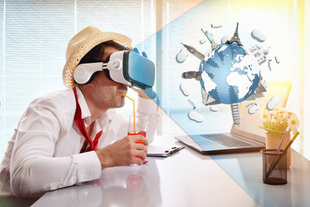 Man working imagining his vacation with vr glasses representation drinking stock photo