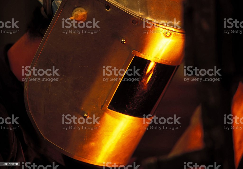 Man working in a siderurgy factory stock photo