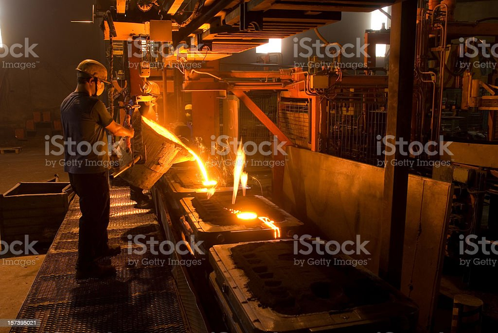 A man working in a steel foundry stock photo