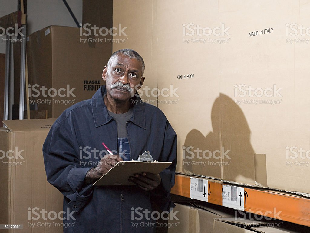Man working in a warehouse royalty-free stock photo