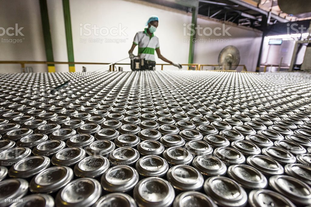 Man working in aluminium can processing plant stock photo