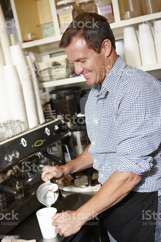 Man working in coffee shop royalty-free stock photo