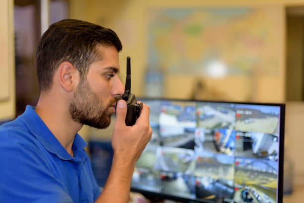man working in control room - talk in a radio foto e immagini stock