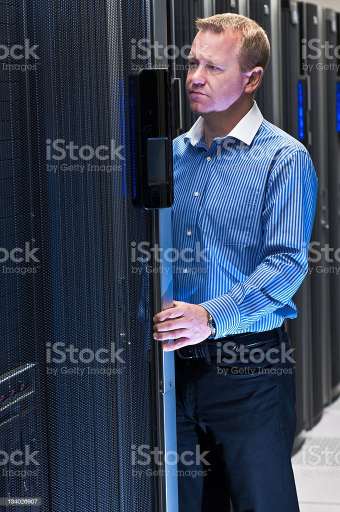 Man working in datacenter royalty-free stock photo