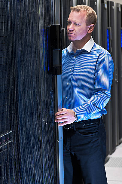 Man working in datacenter stock photo
