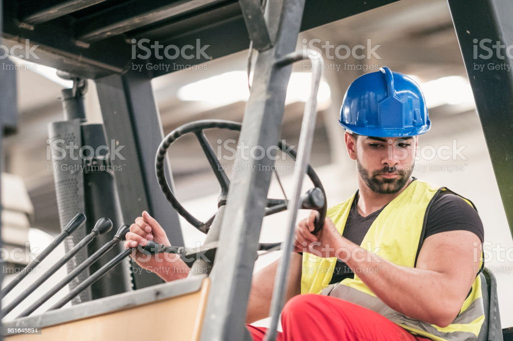 Man working in forklift at concrete factory stock photo