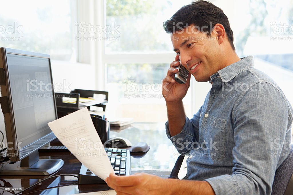 Man working in home office stock photo