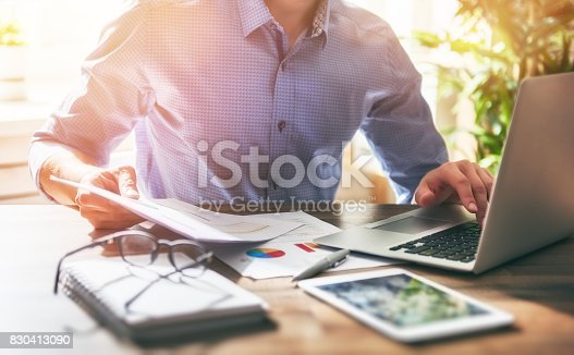 istock man working in office 830413090