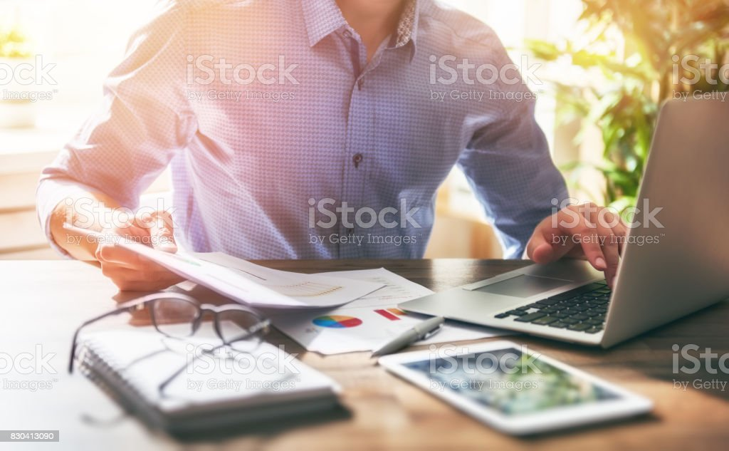 man working in office stock photo