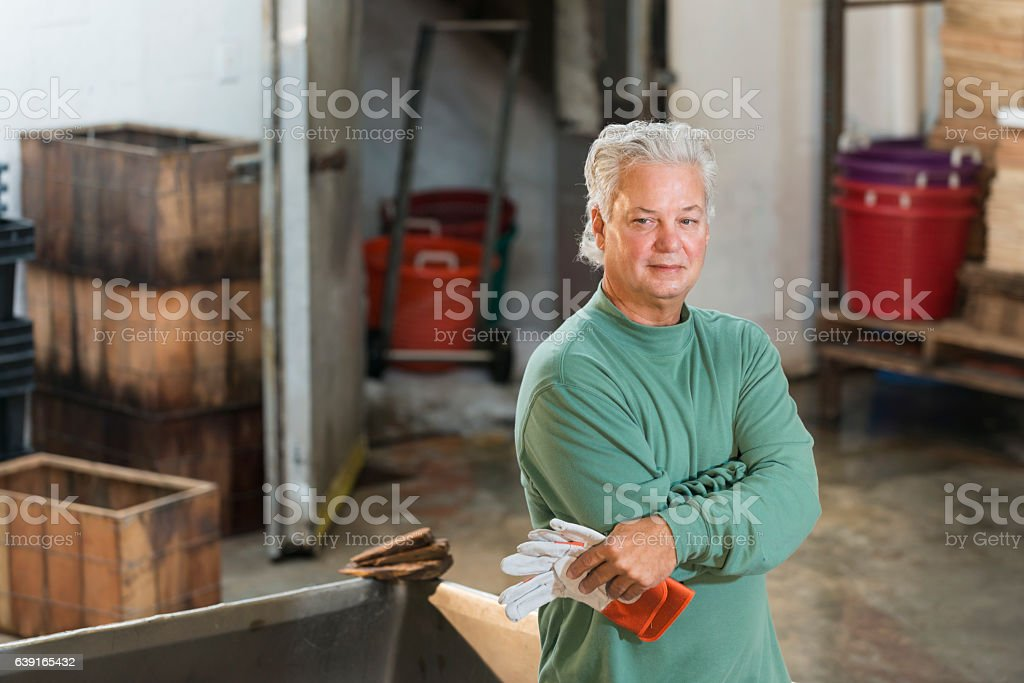 Man working in seafood processing plant stock photo