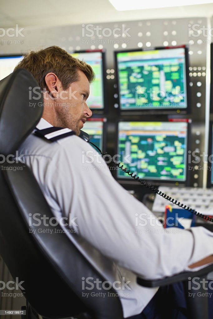 Man working in security control room stock photo