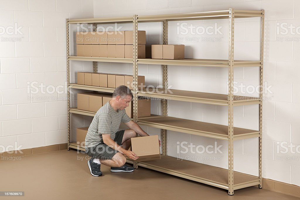 Man Working in Storage Room stock photo