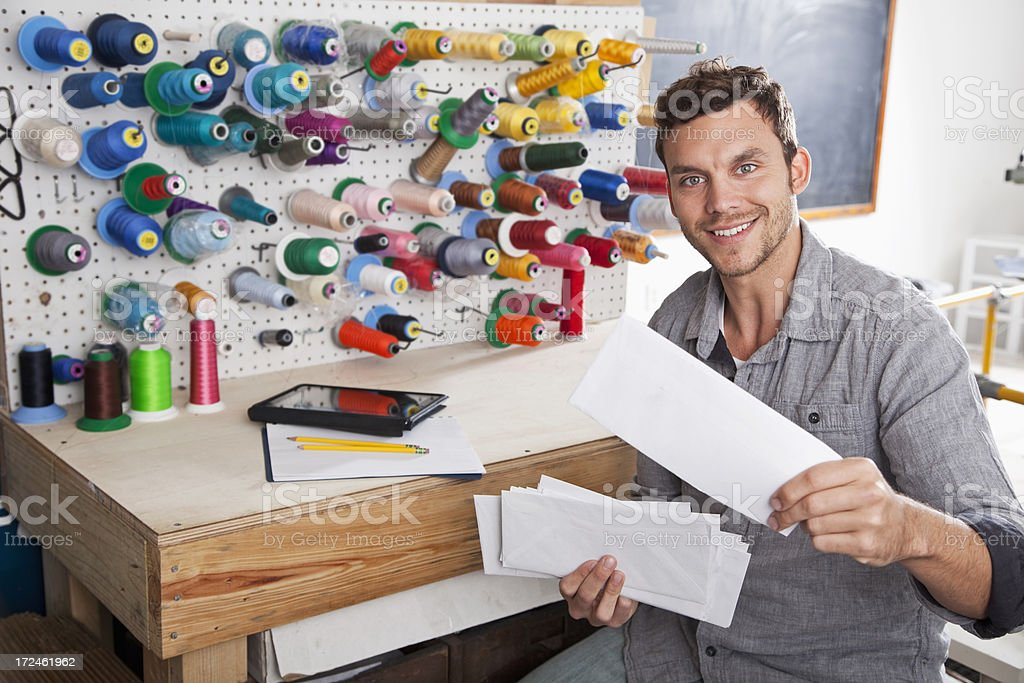 Man working in textile factory stock photo