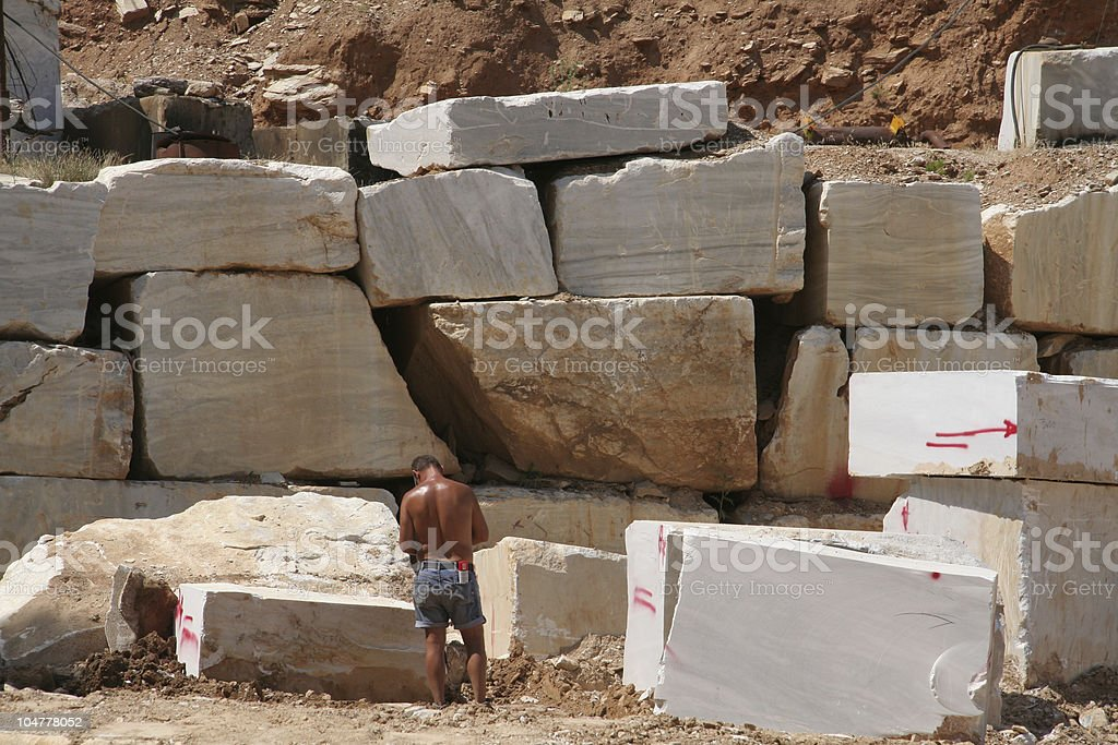 Man working in the marble quarry on Greek island Thassos royalty-free stock photo