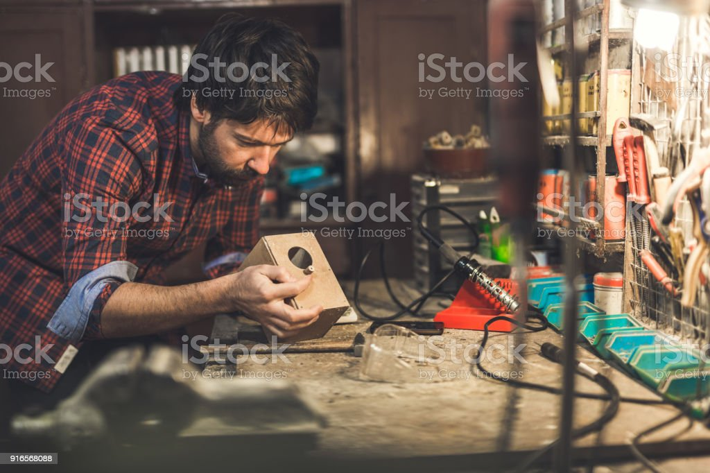 Man working in the workshop stock photo
