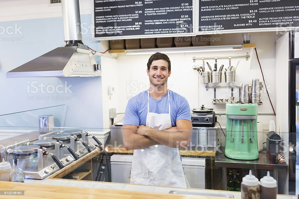 Man working in waffle shop stock photo