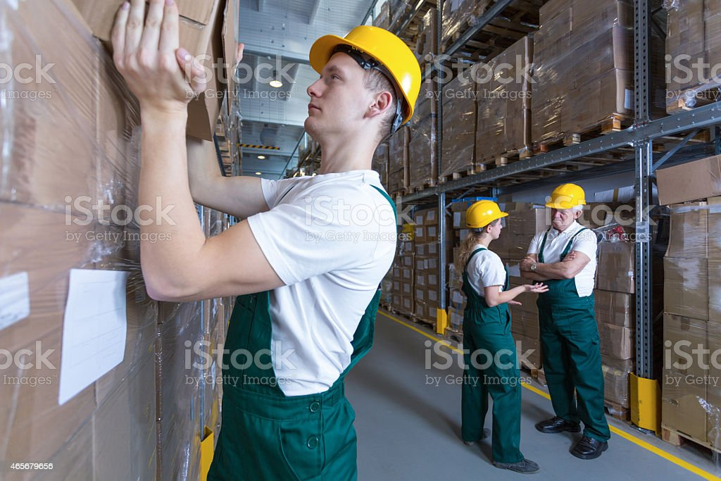 Man working in warehouse stock photo
