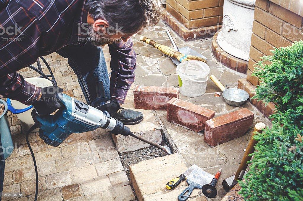 man working in yard puncher stock photo