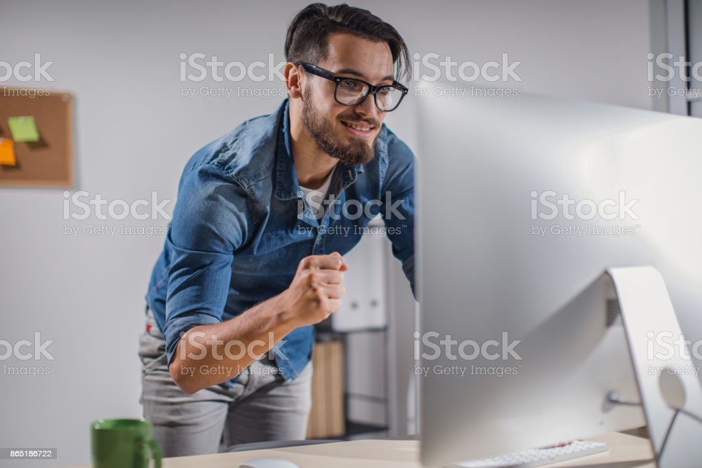 Man working late in the office stock photo