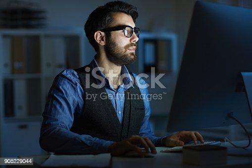istock Man working late 905229044