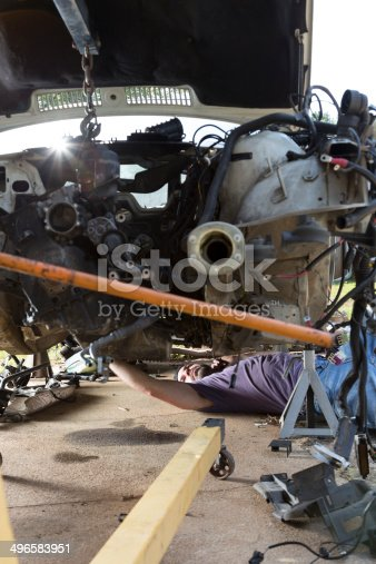498879174 istock photo Man Working on a Car 496583951