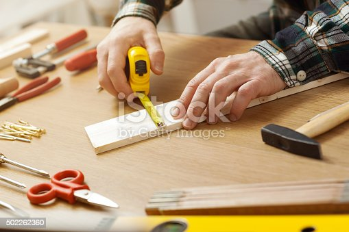 istock Man working on a DIY project 502262360